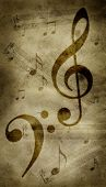 Treble and bass clefs on a grungy parchment