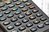 Black scientific calculator keypad closeup on a notebook