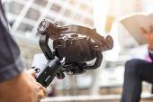 Motorized Gimbal, Videographer Using Dslr Camera Anti Shake Tool  For  Stabilizer Record Video Scene poster