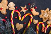New Year And Christmas Background. Christmas Candy Cane Gingerbread  Fir Tree Branches On The Black  poster