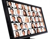 stock photo of connected  - Portraits of smiling people on a computer monitor - JPG