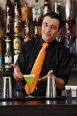 Barkeeper preparing cocktail. Male bartender. Male barkeeper.