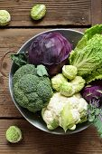 Different Varieties Of Cabbages On Wooden Background. Organic Fresh Vegetables - Cauliflower, Kohlra poster