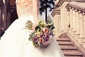 Young Bride In A White Dress With A Beautiful Wedding Bouquet On A Marble Staircase In An Old Castle poster