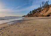 Vast Empty Beach With Pebbles