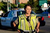picture of lightbar  - A female police officer staring and looking serious during a traffic control shift - JPG