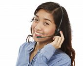 pic of filipina  - A young smiling woman wearing a headset  - JPG