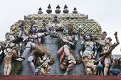 gods and goddesses on the roof of hindu temple