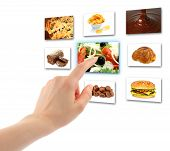image of backround  - Woman hand uses touch screen interface with food on white backround - JPG
