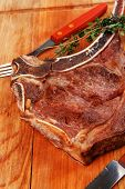savory : grilled spare rib on wooden plate with thyme