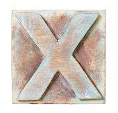Wooden alphabet block, letter X