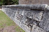 Chichen Itza . Fragment of a wall of a pyramid with an ancient ornament. Yucatan, Mexico