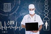 Doctor Hold Laptop On Blue Digital Background