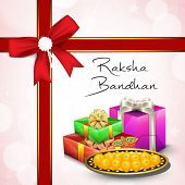Indian festival Raksha Bandhan background with beautiful rakhi, gifts box and sweets.