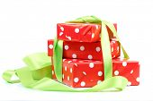 Red gift  boxs tied with a green satin ribbon bow Isolated on white background
