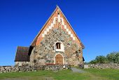 stock photo of olaf  - The St Olafs Church in Tyrvaa Finland is a late medieval stone church in natural setting - JPG