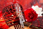 Flamenco comb fan and roses typical from Spain Espana on red background