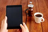 pic of couch  - Young woman uses tablet while relaxing at home with coffee on the sofa couch - JPG