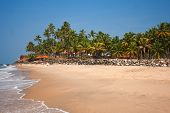 View of the Varkala beach, beach hotel located in a coconut grove behind the breastwork