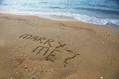 Marry Me Written On Sandy Beach