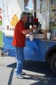 Man Buying Soda at Food Druck