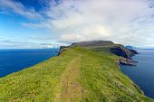 Faroe Islands : Green Hiking Path Surrounded By The Sea
