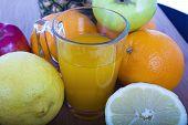 Glasse Of Orange Juice And Fruits