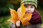 Boy with big leaf