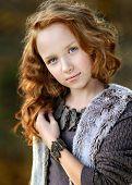 Portrait Of A Beautiful Little Redhead Girl