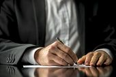 stock photo of fill  - Conceptual image of a man signing a last will and testament document - JPG