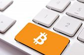 stock photo of bitcoin  - Bitcoin sign on the keyboard - JPG
