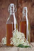 stock photo of elderberry  - Bottles with freshly made elderberry syrup alternative medicine for cough cold or flu - JPG