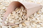 Pumpkin seeds in paper cornet close up