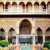 SEVILLE, SPAIN - MARCH 15, 2013: Patio in Real Alcazar Palace, masterpiece of moorish architecture (14th century)