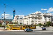 SARAJEVO, BOSNIA AND HERZEGOVINA - AUGUST 12, 2012: Tram and cars passing by high school building in Zmaja od Bosne street with Avaz Twist Tower in the background.