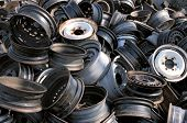 stock photo of reuse recycle  - Pile of rims in a dumpster for metal recycling - JPG