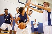 picture of indoor games  - Male High School Basketball Team Playing Game - JPG