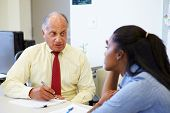image of 70-year-old  - Female Student Talking To High School Counselor - JPG