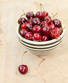Bowl of sweet cherry on a table