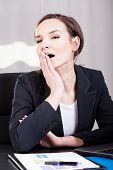Businesswoman Yawning In An Office