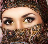Muslim woman with brown eyes