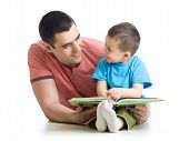 Kid Boy And His Dad Read A Book