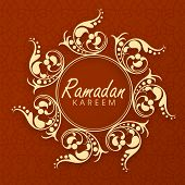 Circle frame with stylish text Ramadan Kareem decorated by golden floral designs.