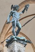 stock photo of perseus  - Perseus with the Head of Medusa the famous bronze statue by Benvenuto Cellini in Piazza della Signoria - JPG