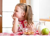 stock photo of dislike  - kid girl refuses to eat healthy food - JPG