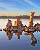 The picturesque sunset at Mono Lake.  Outliers - bizarre calcareous tufa formation reflected in the smooth water.