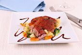 stock photo of duck breast  - Roasted duck breast vegetables and black sauce close up - JPG