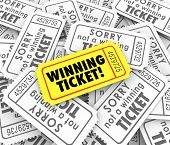 stock photo of prize  - One winning ticket on pile of losing entries in lottery or raffle for cash or prizes - JPG