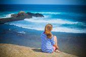 Girl relaxing at coastline