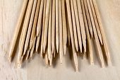 The Pile Of Toothpicks On A Wooden Surface